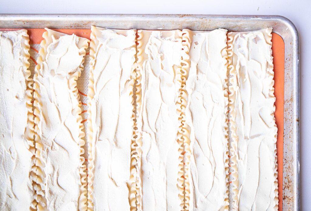 lasagna noodles on a baking sheet with tofu ricotta