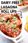 "one large and one small casserole dish filled with vegan lasagna roll ups and a cloth napkin off to the side and a text overlay that reads ""dairy-free lasagna roll ups"""