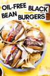 """three oil-free black bean burgers in a cake tin with tortilla chips and a text overlay that reads """"Oil-Free Black Bean Burgers"""""""
