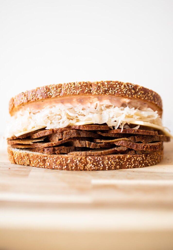 a vegan reuben sandwich on a cutting board
