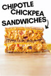 """two halves of chipotle chickpea melts stacked on top of each other with a text overlay that reads """"chipotle chickpea sandwiches"""""""