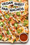 """large sheet pan of vegan nachos with a side of salsa with a text overlay that reads """"vegan sheet pan nachos"""""""