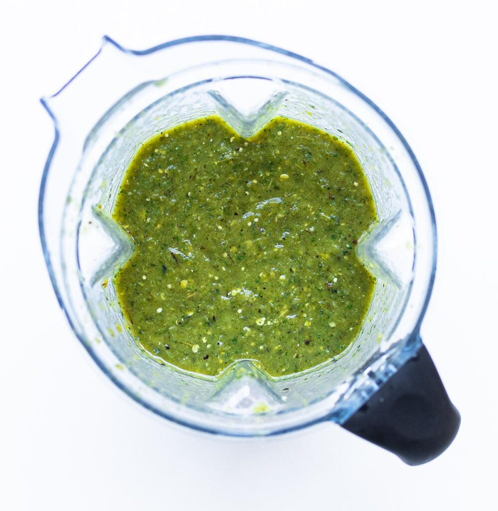 a blender filled with tomatillo salsa