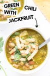 """two bowls of chili verde with jackfruit with spoons and a napkin and a text overlay that reads """"chili verde with jackfruit"""""""